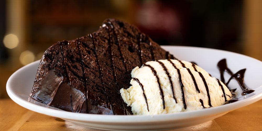 close up of chocolate cake and vanilla ice cream